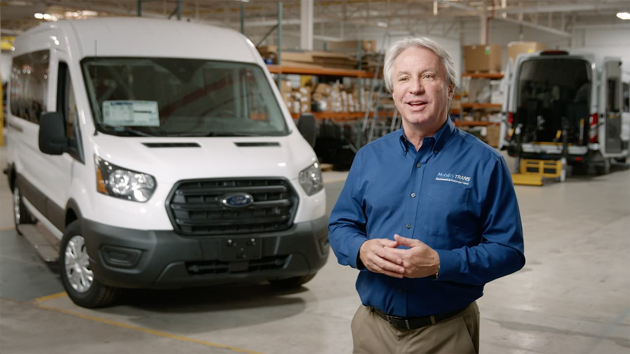 President, Dave Brown standing in front of a van