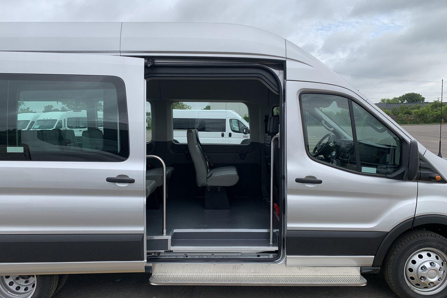 Passenger van door open with foot step