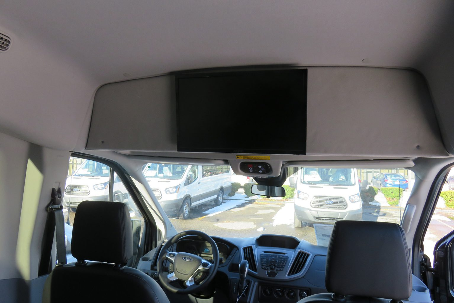 Van with ceiling mounted tv