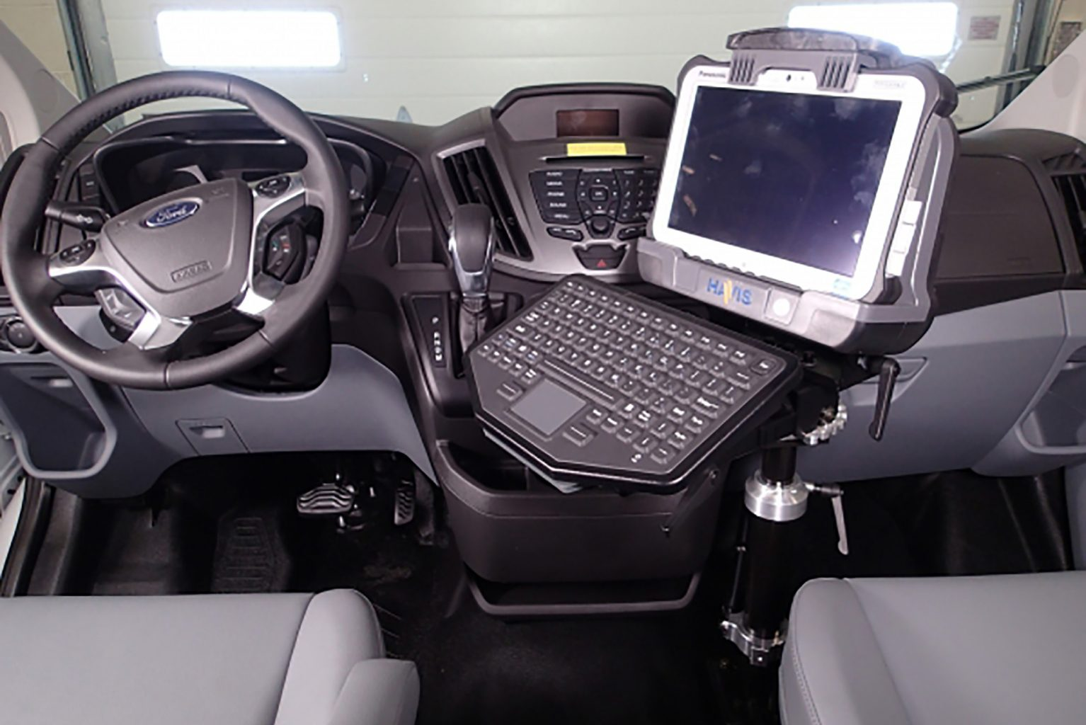 Computer mounted inside Prisoner Transport van dashboard